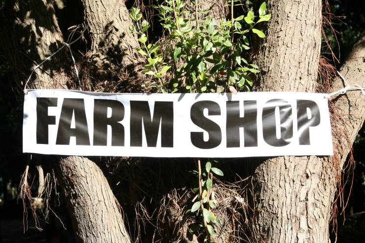 farm shop sign, a canvass banner outdoors in summer